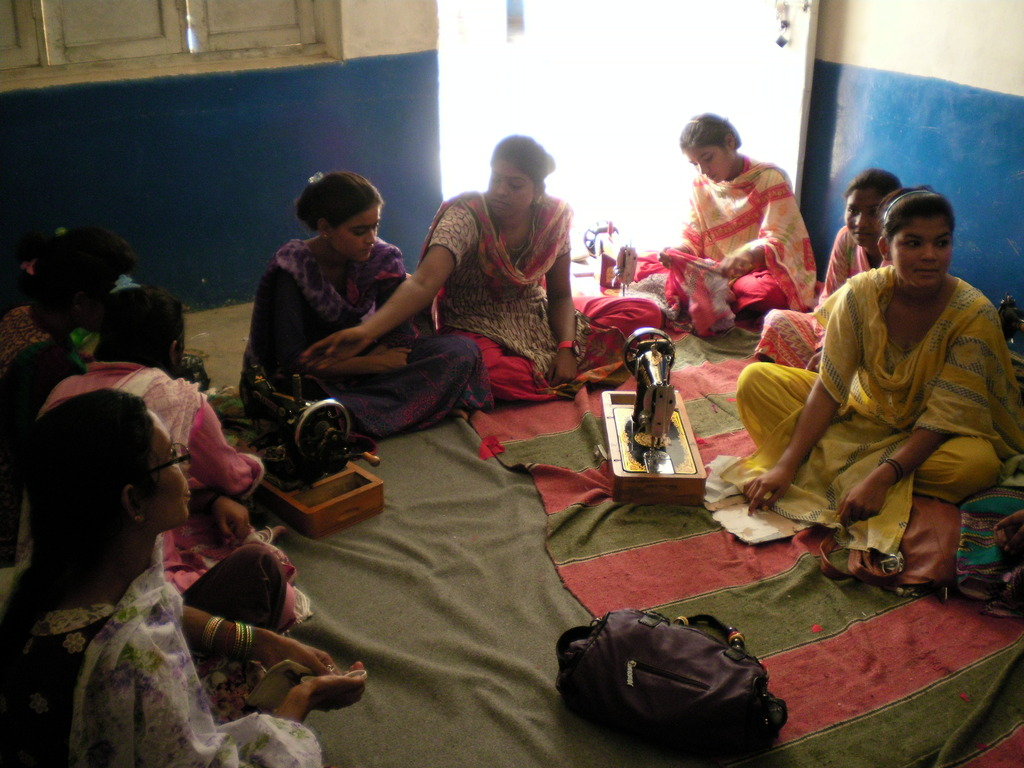 A Group of women learning sewing & cutting
