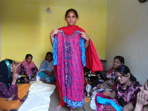 Girl trained and sewing cloths succesfully