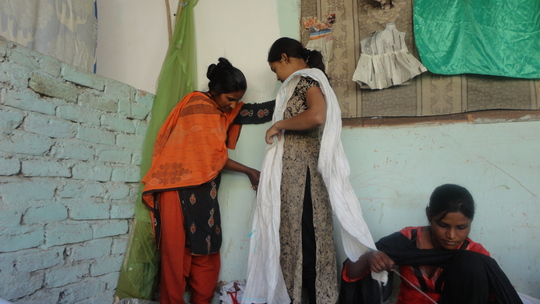 Young women busy in sewing