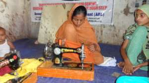 Girl sewing children cloths