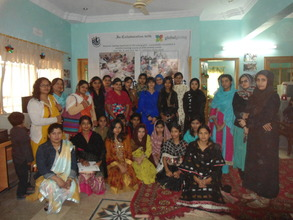 Groups Photo sewing center students at AHD office