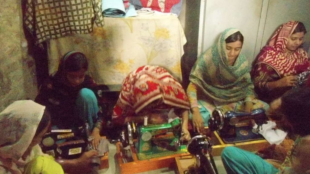 Women learning the sewing in sewing center