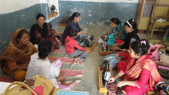 Young women learnning sewing skills