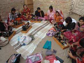 23 young girls learning sewing skills at unit 5