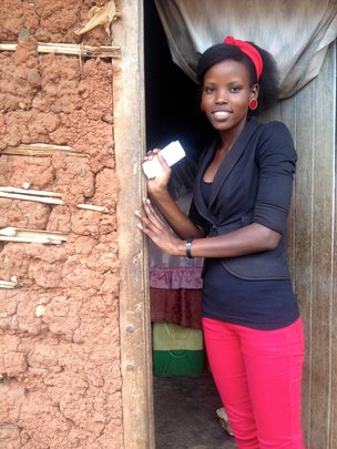 Alice Outside Her Home in a Ugandan Slum