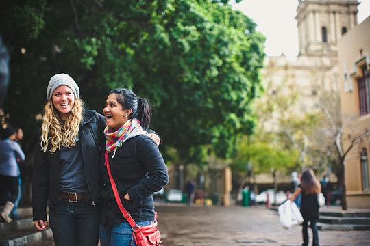 Scholar Myomena and staff Elizabeth on campus