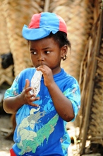 Young boy eating Supplementary'Plumpy®