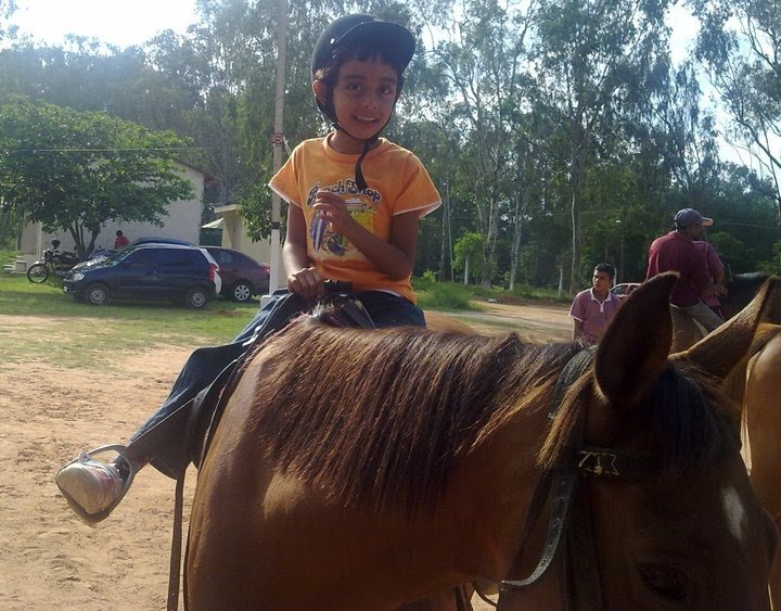 Reuel on horseback; equestrian therapy