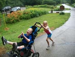 Kaylie Pushing Kyle in his Stroller