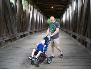 Kyle on a Covered Bridge with his Daddy