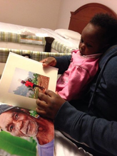 Showing Princess some of our Haiti pictures
