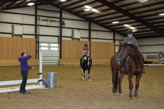 Riders in the indoor arena