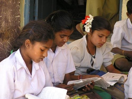 Girls studying in a primary school in Andhra Pradesh  SLS complements reading and writing development taking place in schools.
