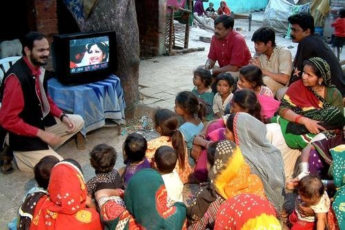 Understanding impact of Same Language Subtitling (SLS) for mass literacy  Brij Kothari discussing SLS in Gulbai Tekra slum, Ahmedabad. The idea struck him while watching Spanish films with English subtitles, during his Ph.D. at Cornell University.