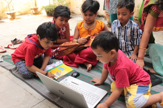 Village kids engaged with digital story