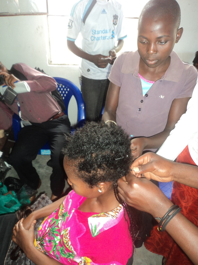 GIrls in hairstyle training at Children