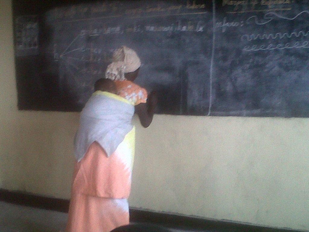 A woman in literacy class in Kibati center,