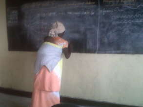 A woman in literacy class in Kibati center,