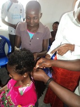 Children in vocational training in fixing hair