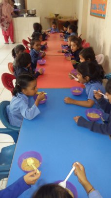 Breakfast for KG school-children in Pakistan
