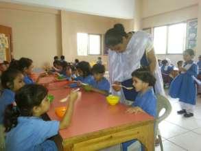 Students enjoying wheat porridge