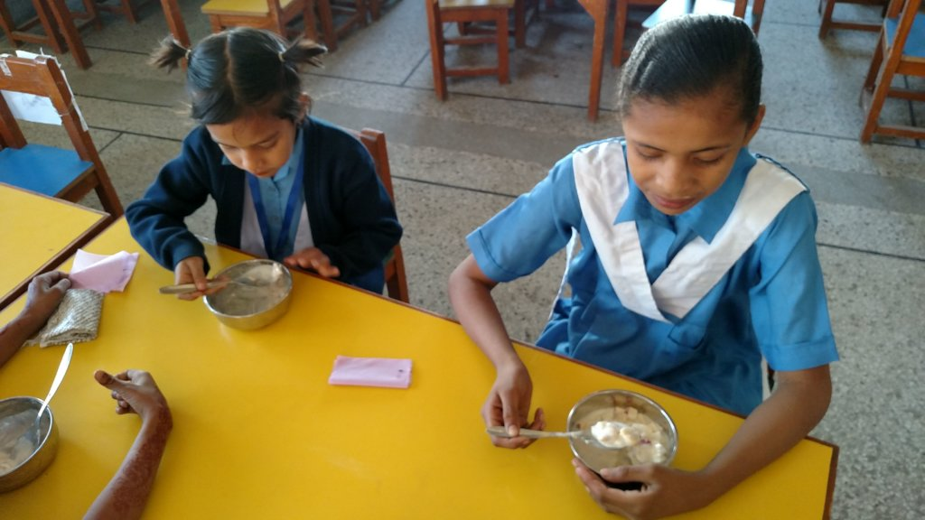 Girls eating in the new safe utensils