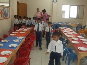 Children lining up to get breakfast