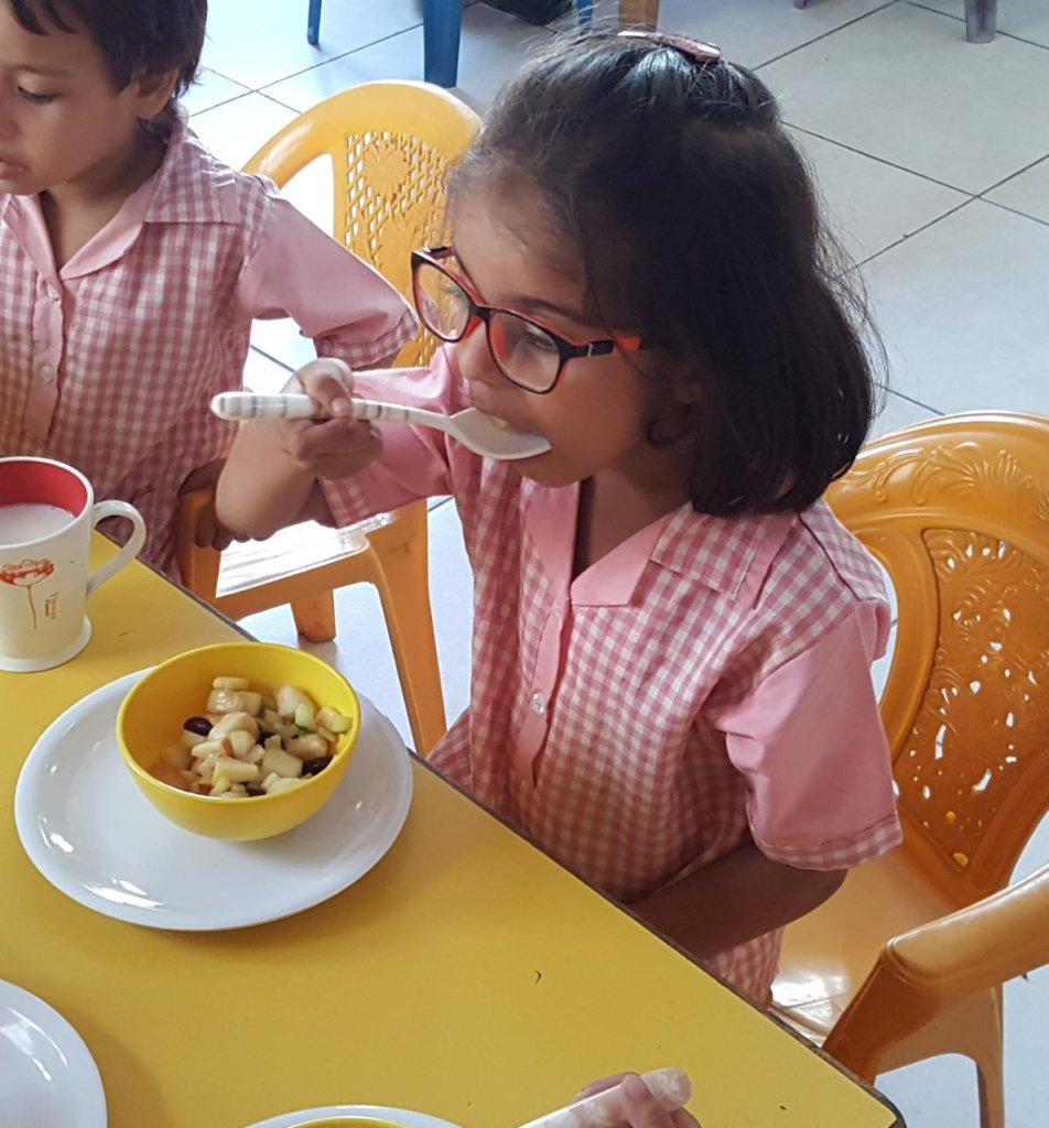 A student enjoys fruit salad