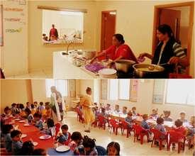 Teachers preparing and serving breakfast