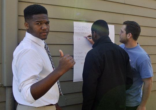 Joe Lopez (on right) guides youth toward health.