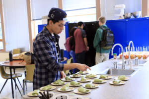 Luis prepares for his cooking demonstration.