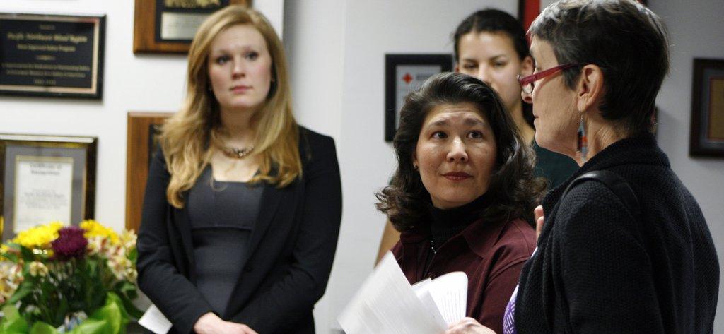 Susan Li (center) of Pacific University Reports