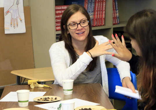 Vanessa engages youth in hands-on activities.