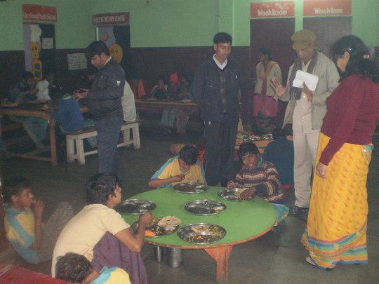 Children enjoying feast following Pooja