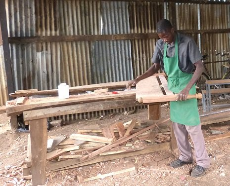 Bosco making a Bed in his rented Workshop