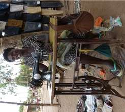 Susan working at Bweyale market for 1 per day