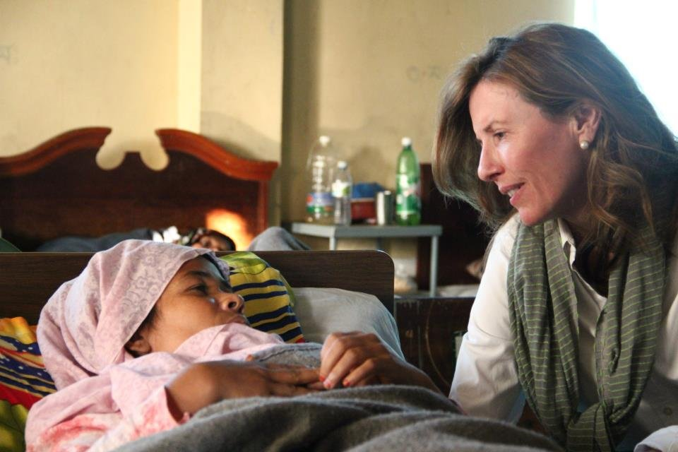 Kate Grant visiting a recovering fistula patient.