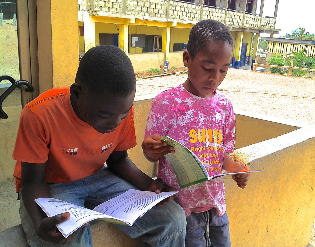 Kwesi and Derek enjoy reading their new textbooks!