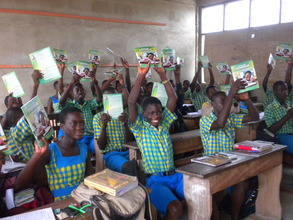 Class JHS2 students with their new textbooks.