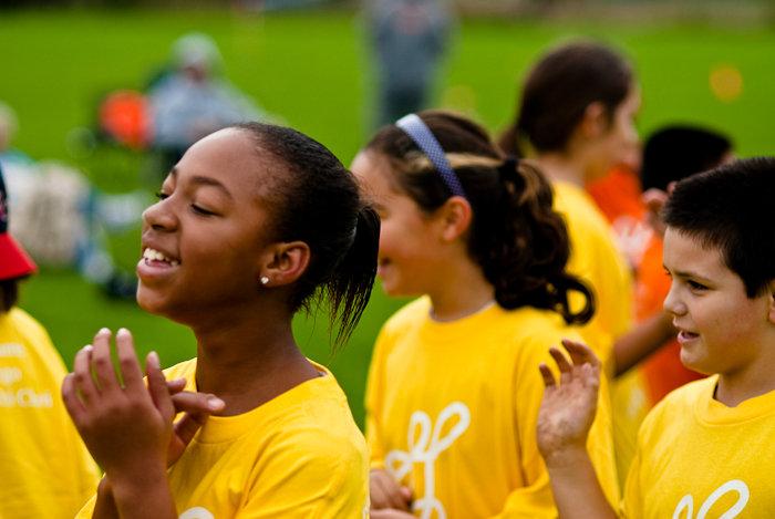 Smiling Playworks kids after a game