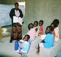 A teacher and her Grade 1 class