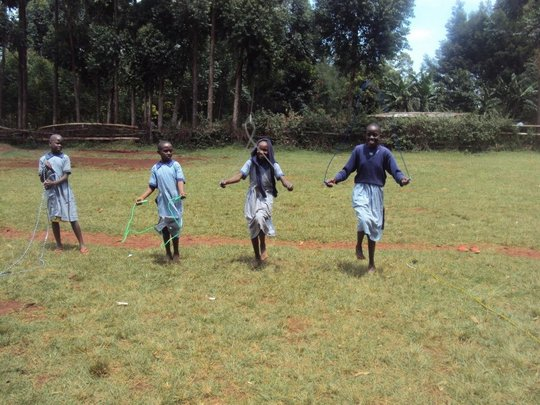 Nyakongo primary school pupils using the new items