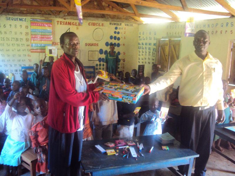 HWF staff handing over the materials to ECD teache