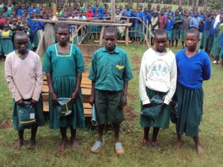 orphans in Nyambaria school receiving uniforms