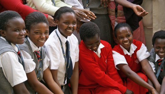 Group of happy Akili Dada scholars