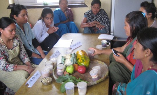Mothers at center learning about good nutrition