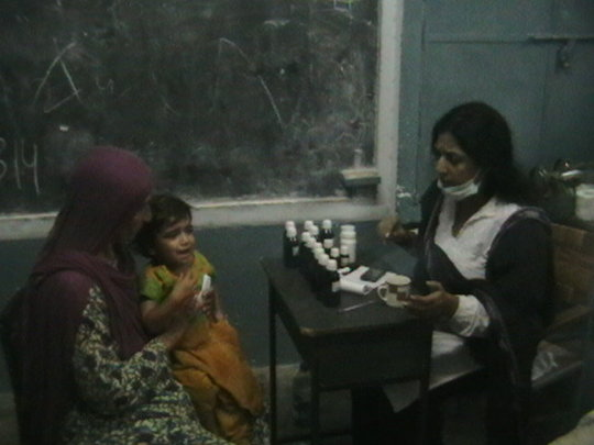 Lady doctor examines a patient in Balochistan