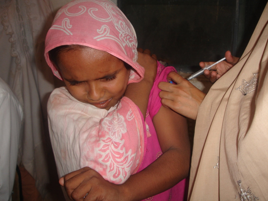 Receiving a  vaccination
