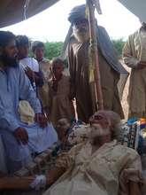 Dr Babar Ali tends to an elderly man