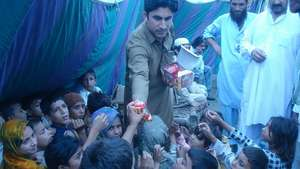 Distributing biscuits among the children